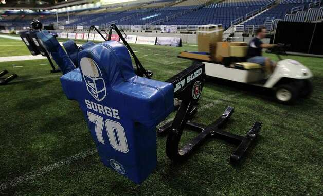 Movers take equipment out of the Alamodome as the Dallas Cowboys training camp comes to a close on Tuesday, Aug. 9, 2011. Kin Man Hui/kmhui@express-news.net Photo: KIN MAN HUI, -- / SAN ANTONIO EXPRESS-NEWS