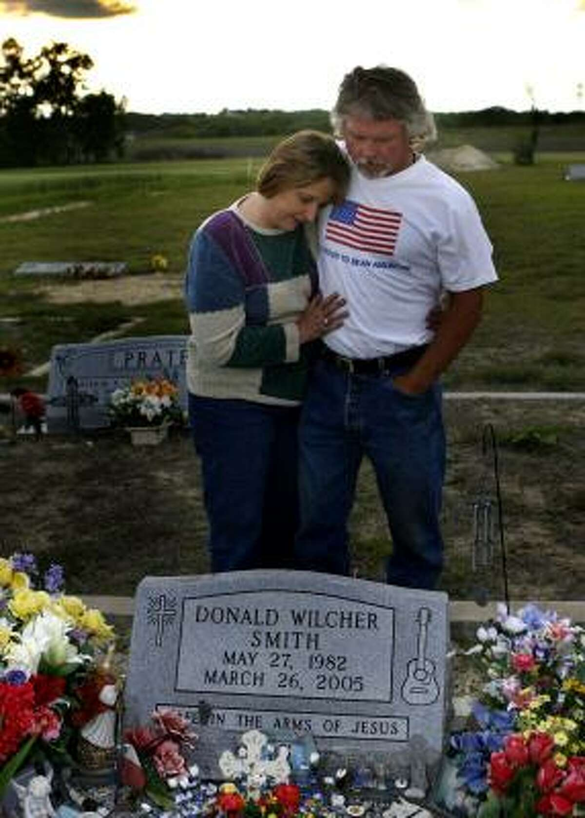 Tricia and Coit Smith visit their son's grave outside Temple every day. Their son, Donald W. Smith, died in a work accident at a chicken plant in Bryan in March 2005.