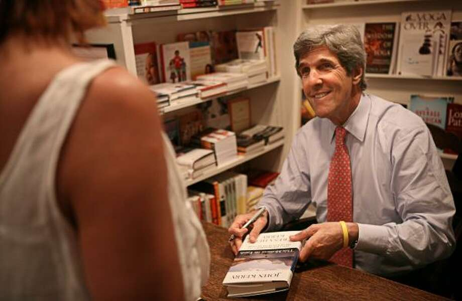 John Kerry pays a visit to Brazos Bookstore to sign his new book This Moment on Earth, which deals with environmental issues. Photo: ERIN TRIEB, FOR THE CHRONICLE