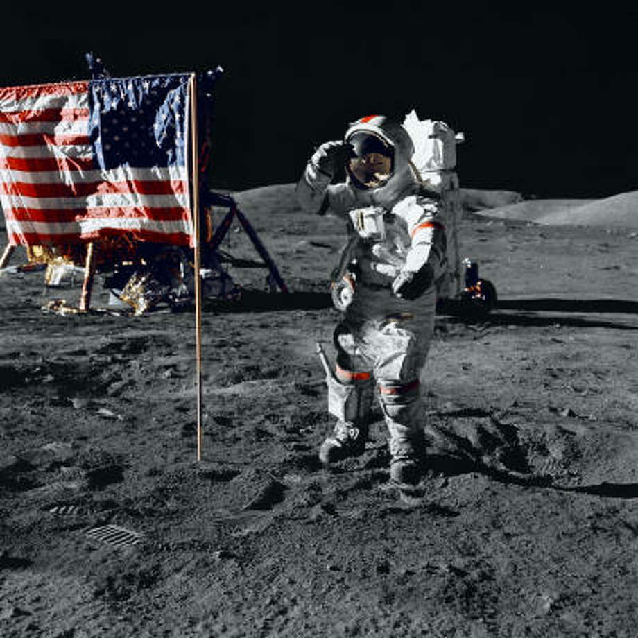 An astronaut salutes the U.S. flag as he stands on the surface of the moon in the film In the Shadow of the Moon. Photo: NASA