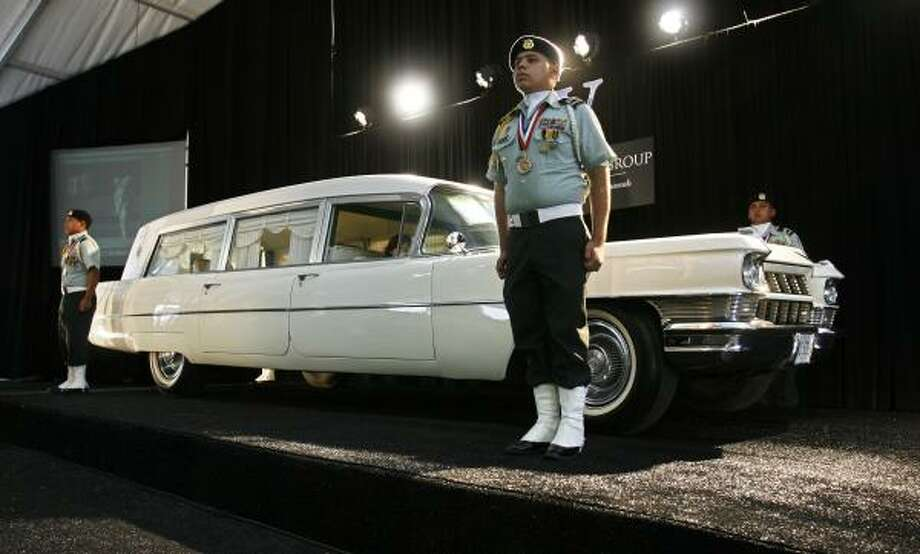 JROTC honor guards from Sam Houston High School watch over the hearse that carried the body of President Kennedy. Photo: JOHNNY HANSON PHOTOS, FOR THE CHRONICLE