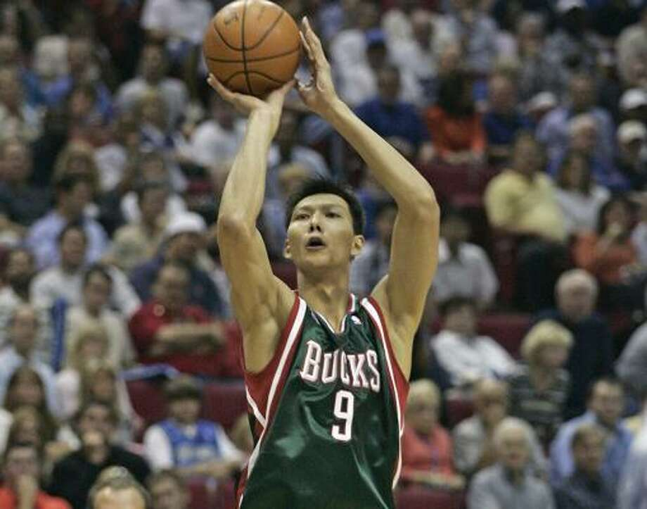Bucks forward Yi Jianlian comes into Friday's showdown at Toyota Center averaging 9.8 points and 4.8 rebounds a game. Photo: Reinhold Matay, AP