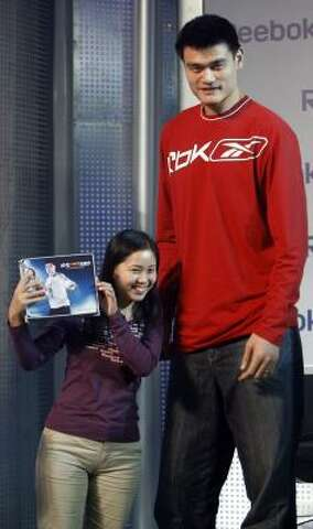 80d3632c4 Yao Ming thrilled a fan in Beijing with a gift in September. He and  Milwaukee