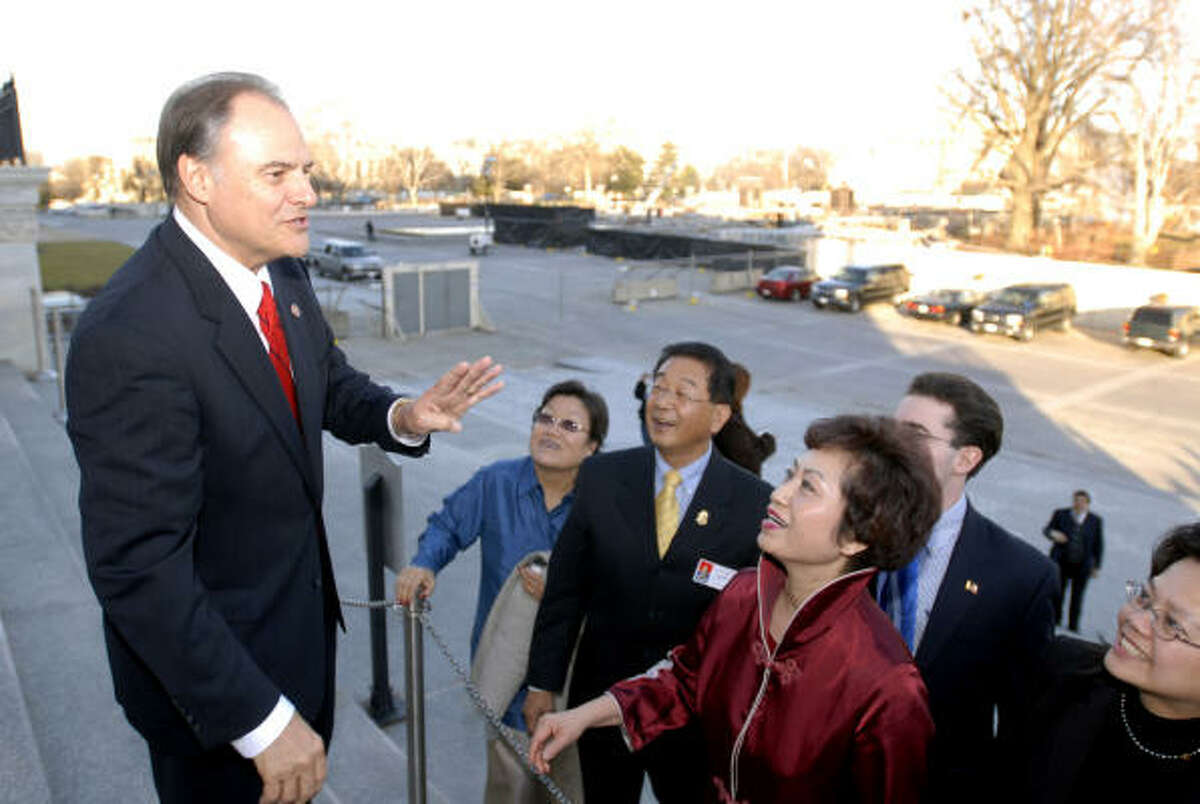 Rep. Nick Lampson, D-Stafford, pauses outside the Capitol to talk Thursday with New York tourists who had seen him on C-SPAN.
