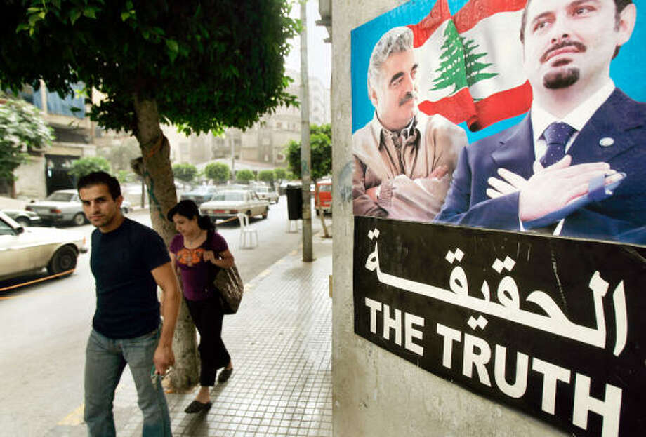 "The issue of the tribunal has sharply divided Lebanon. In downtown Beirut, Hariri loyalists hung posters with images of him and his son above the words ""the truth"" in both English and Arabic. Photo: BEN CURTIS, AP"