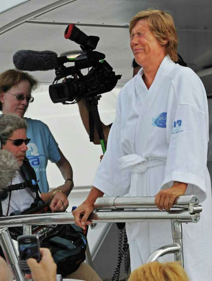 In this photo provided by the Florida Keys News Bureau, Diana Nyad, right, cries as she speaks to reporters and fans after arriving back in Key West, Fla., Tuesday, Aug. 9, 2011, following the 61-year-old marathon swimmer's failed attempt to swim from Cuba to the Florida Keys. (AP Photo/Florida Keys News Bureau, Rob O'Neal) Photo: Rob O'Neal, AP / AP2011
