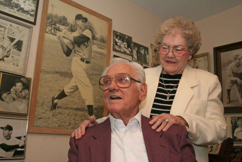 Ed Stevens and his wife, Margie, filled a room with photos and memories from Ed's baseball career. Photo: Gary Fountain, For The Chronicle
