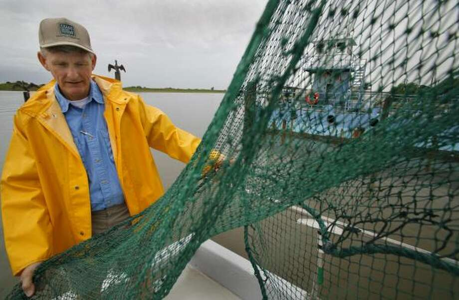 Texas Parks and Wildlife biologist Norman Boyd says the challenge in maintaining Texas' rivers is to avoid changes that alter the mix of waters in the bay, which harms the ecosystem. Photo: STEVE UECKERT, CHRONICLE