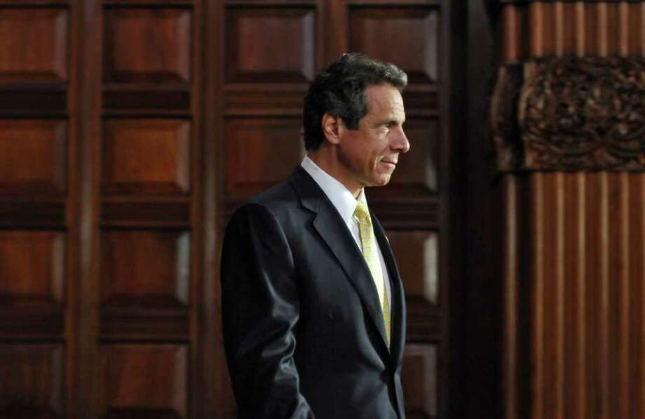 Governor Andrew Cuomo arrives in the Red Room for the signing ceremony of the NYSUNY2020 bill at the Capitol on Tuesday Aug. 9, 2011 in Albany, NY. (Philip Kamrass / Times Union) Photo: Philip Kamrass / 00014201A