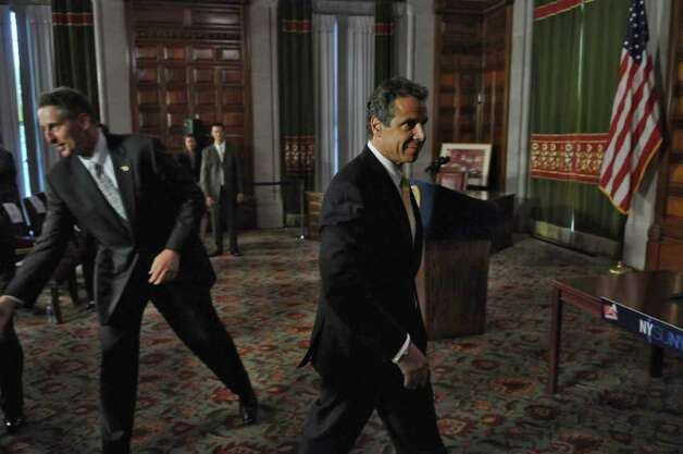 Governor Andrew Cuomo heads to his office after the signing ceremony for the  NYSUNY2020 bill in the Red Room at the Capitol on Tuesday Aug. 9, 2011 in Albany, NY. Behind him is Lt. Governor Robert Duffy.  (Philip Kamrass / Times Union) Photo: Philip Kamrass / 00014201A