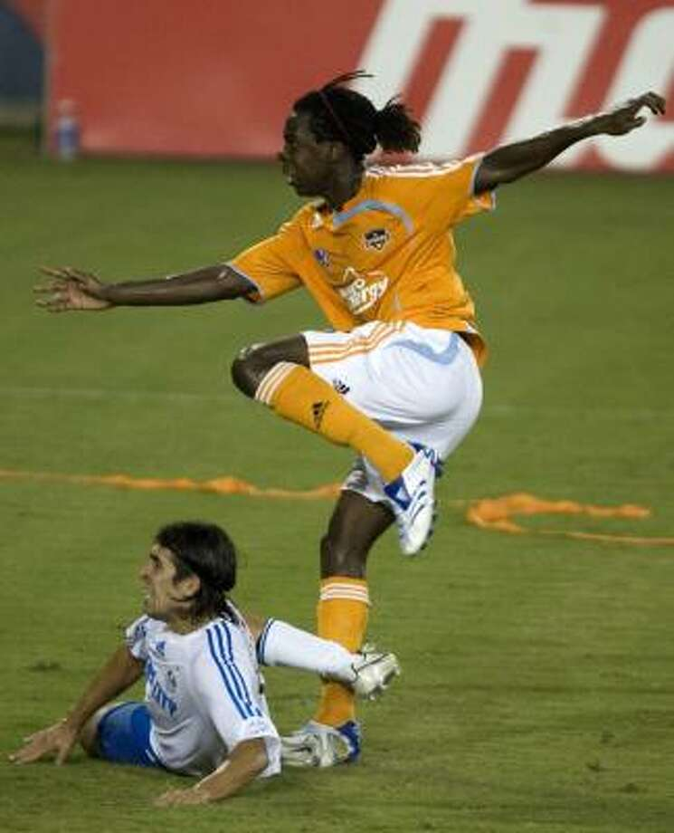 Joseph Ngwenya (top) scores in Saturday's 1-1 tie against Kansas City to give the Dynamo a valuable point in the race for the West. Photo: BOB LEVEY, FOR THE CHRONICLE