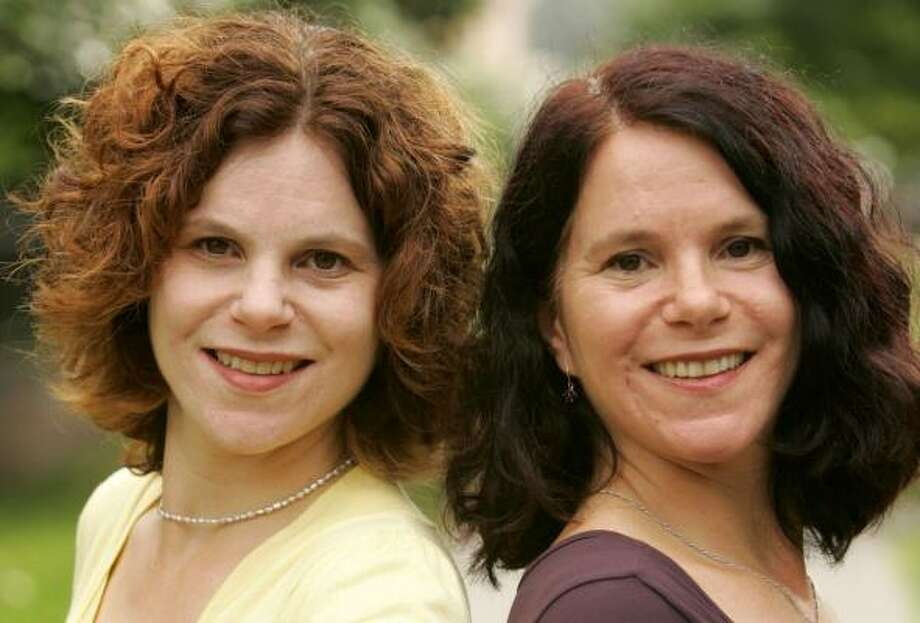 Paula Bernstein, left, and Elyse Schein are identical twins who were separated at birth and reunited 35 years later. They have written a book about their lives, Identical Strangers. Photo: BRUCE GILBERT, MCCLATCHY