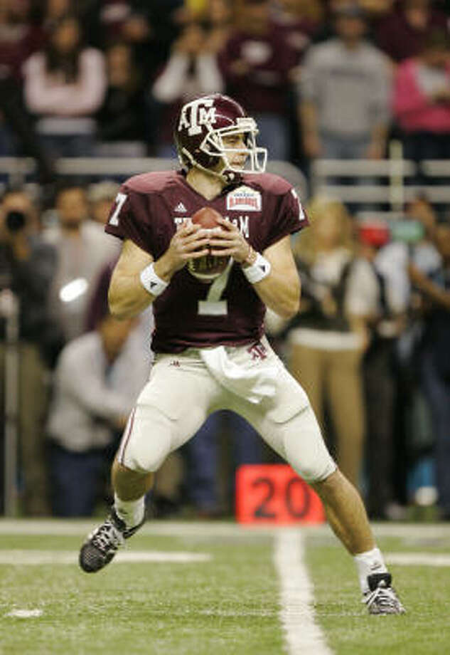 Stephen McGee was 19-of-31 for 161 yards and an interception for A&M. Photo: Brian Bahr, Getty Images