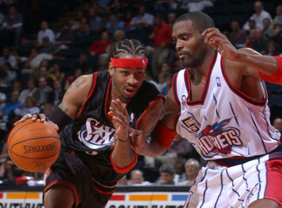 Allen Iverson, then with the Sixers, looks for a way past Cuttino Mobley of the Rockets at Compaq Center in 2002. Photo: KAREN WARREN, CHRONICLE