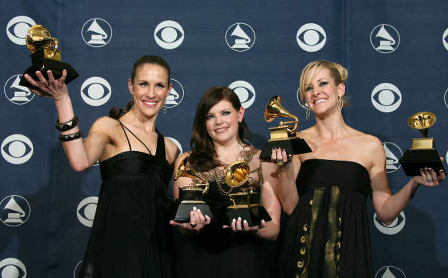 Members of the Dixie Chicks, Emily Robison, left, Natalie Maines and Martie Maguire, pose with their trophies at the 49th Grammy Awards in Los Angeles on Feb. 11. Photo: GABRIEL BOUYS, AFP/GETTY IMAGES