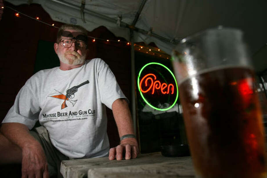 Fred Turton, founder of what is really an imaginary club, the Montrose Beer & Gun Club, serves up a beer at Cecil's Tavern. The fictitious club and the fictitious members are planning a cookoff that raises money for the Make a Wish Foundation. Photo: Sharon Steinmann, Chronicle