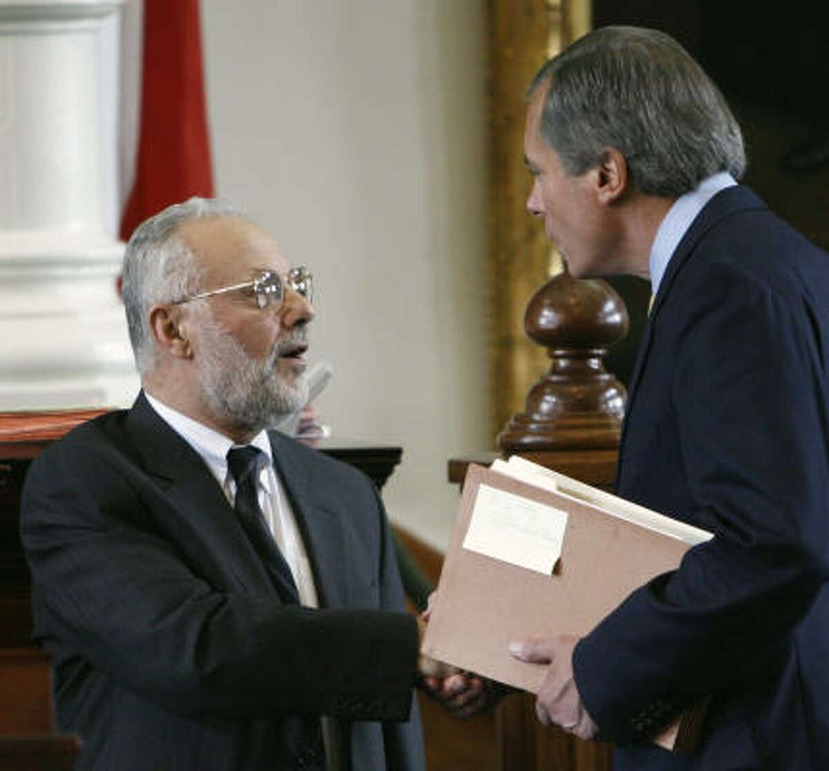 Imam Dr. Yusuf Kavakci, left, is welcomed to the Texas Senate by Lt. Gov. David Dewhurst, right, in Austin, Texas.