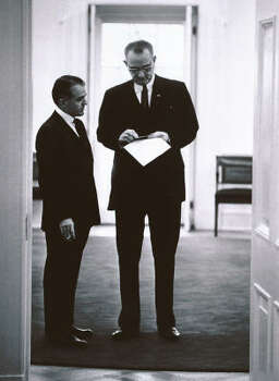 President Lyndon Johnson pauses near the door of his office for a brief conference with his close aide Jack Valenti in Washington Feb. 8, 1964. Photo: AP File
