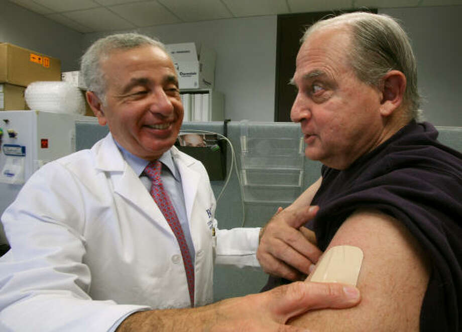 Dr. Joseph Jankovic replaces a Parkinson's patch during a consultation with patient James Papadakis last week. Photo: Steve Campbell, Chronicle