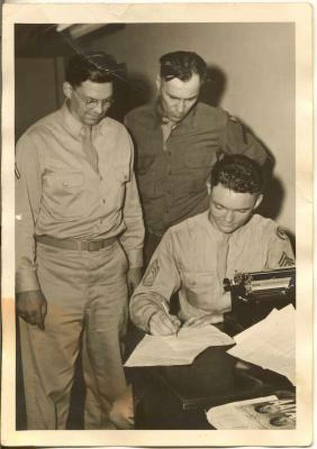 Tech. Sgt. Leon Hale at work in Santa Monica, Calif., following World War II. The other two men are unidentified. Photo: Family Photo