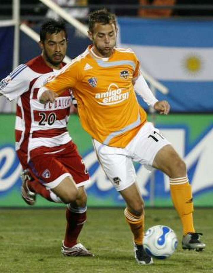 Midfielder Brad Davis, right, and the Dynamo must defeat FC Dallas by two goals to advance in regulation Friday. Photo: AMY CONN-GUTIERREZ, ASSOCIATED PRESS