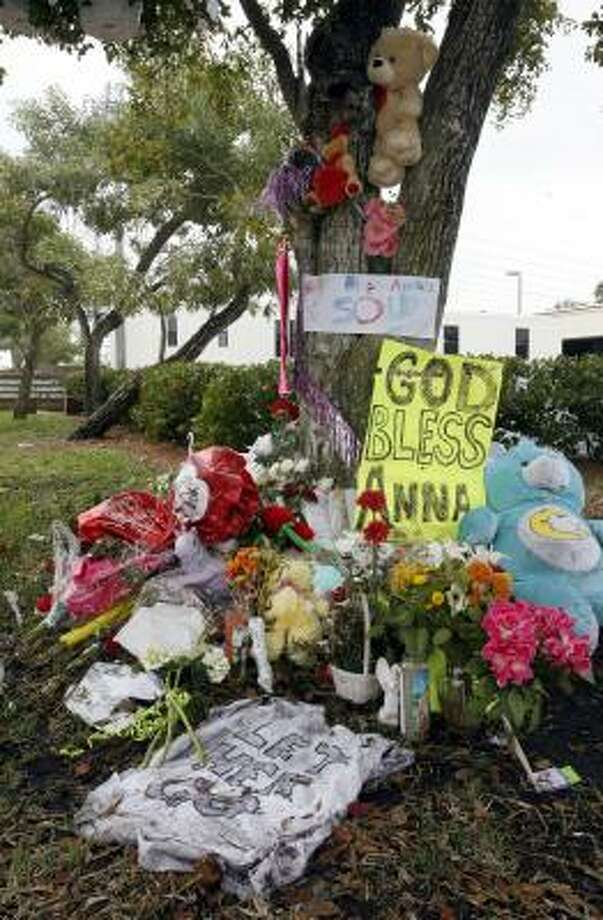 Pink flowers tight guest list for anna nicoles funeral houston a shrine for anna nicole smith grows outside the broward county medical examiners office in hollywood mightylinksfo