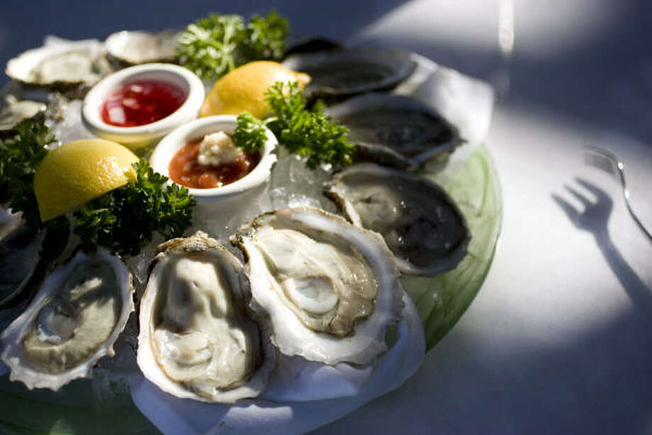 Oysters on the half shell, such as these at McCormick & Schmick's Seafood Restaurant in Houston, can be eaten plain or with toppings. Photo: KAREN WARREN, Chronicle