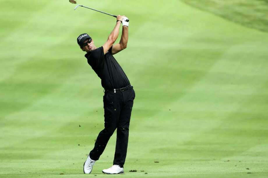 AKRON, OH - AUGUST 07:  Adam Scott of Australia hits his second shot on the sixth hole during the final round of the World Golf Championships-Bridgestone Invitational on the South Course at Firestone Country Club on August 7, 2011 in Akron, Ohio.  (Photo by Andy Lyons/Getty Images) Photo: Andy Lyons