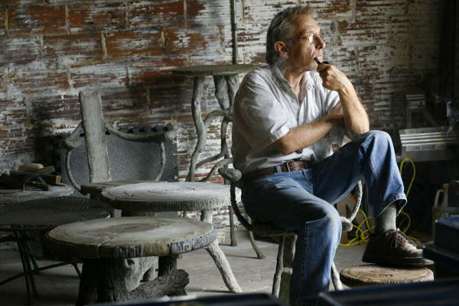 Faux bois artist Donald Tucker sits in his new studio on Nance Street, surrounded by tables and benches he has sculpted from steel, concrete, mortar and cement. Photo: Nick De La Torre, Chronicle