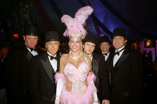 In this photo released by Playboy, Anna Nicole Smith poses with Larry Birkhead, second from left, Howard K. Stern, right, Anna Nicole Smith's son Daniel Smith, third from right, and unidentified guests during the 2004 Halloween party at the Playboy Mansion in Los Angeles. Photo: Kenneth Johansson, AP