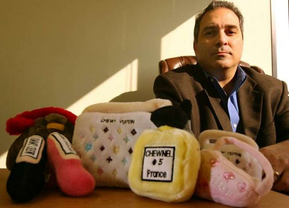 Houston attorney James Petruzzi represents Haute Diggity Dog, a Nevada business dealing in plush toys for pets that parody major fashion brands. It's in a trademark battle with French fashion and liquor conglomerate Louis Vuitton Group over some of the toys. Photo: SHARÓN STEINMANN, CHRONICLE