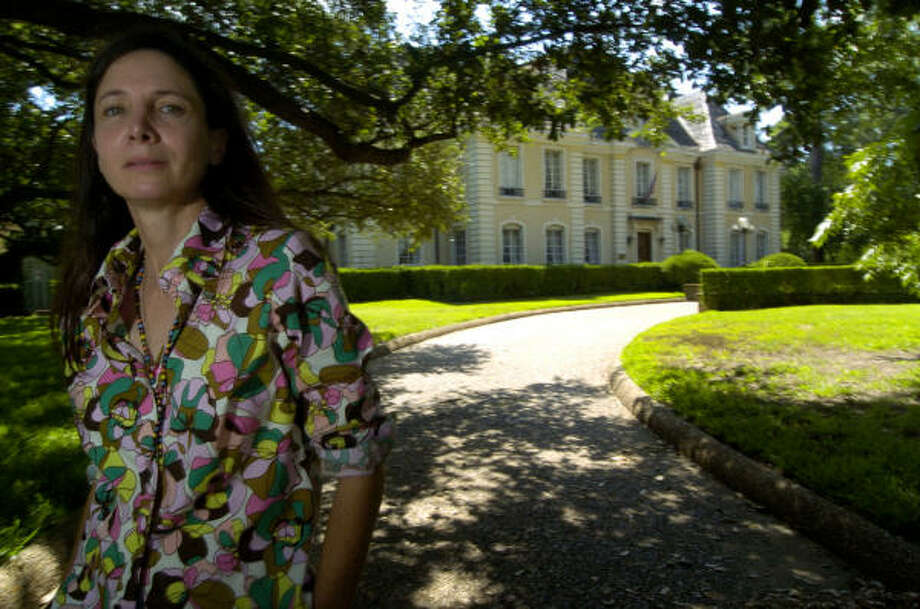 Susan Conte stands in front of her family's River Oaks mansion. The Conte family is fighting the probate court for what they consider to be a waste of more than $1 million of their money. Photo: Johnny Hanson, For The Chronicle