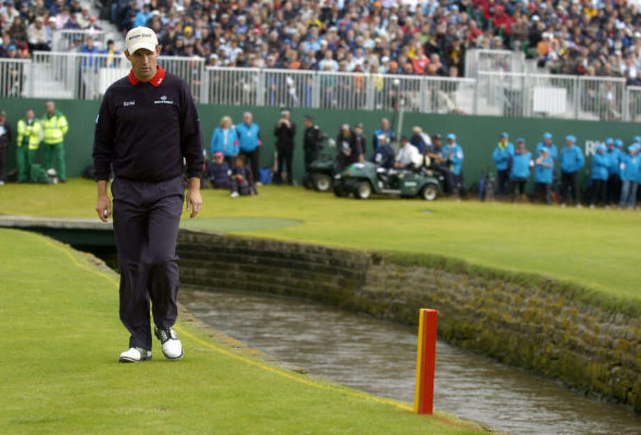 Padraig Harrington found the burn twice on No. 18, conjuring images of Jan Van de Velde's meltdown on the hole in 1999. Photo: PAUL ELLIS, AFP/Getty Images