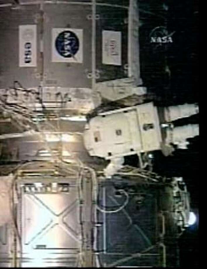 Astronaut Dan Tani helped reroute power cables and cooling lines Tuesday. Photo: ASSOCIATED PRESS, NASA TV