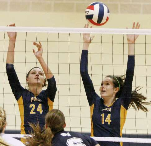 Poth's Micah Weaver (left) and Kelsee Felux defend  against Smithson Valley on Tuesday, Aug. 9, 2011. Poth outlasted Smithson Valley 25-20, 25-22, 20-25, 25-22 in both teams' season opener. Photo: Darren Abate/Special To The Express-News