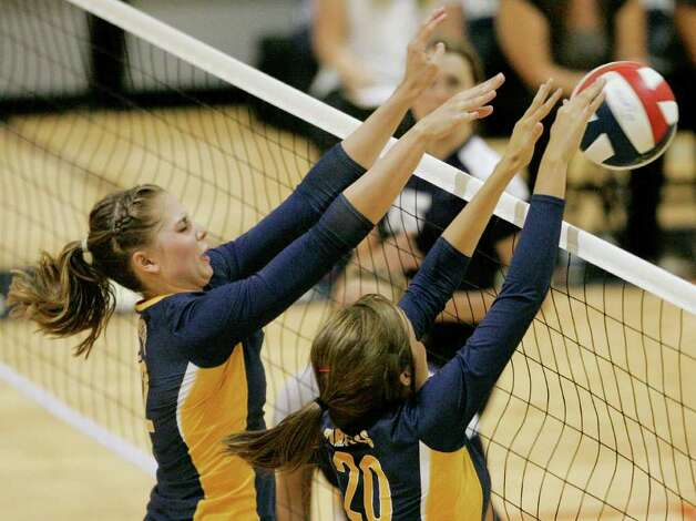 Poth's Jordan Kotara (left) and Tara Broyles defend the net against Smithson Valley on Tuesday, Aug. 9, 2011. Poth outlasted Smithson Valley 25-20, 25-22, 20-25, 25-22 in both teams' season opener. Photo: Darren Abate/Special To The Express-News