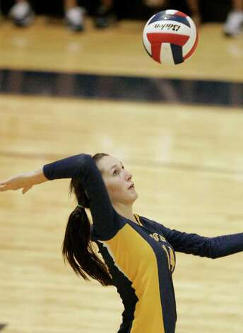 Poth's Kelsee Felux serves the ball against Smithson Valley on Tuesday, Aug. 9, 2011. Poth outlasted Smithson Valley 25-20, 25-22, 20-25, 25-22 in both teams' season opener. Photo: Darren Abate/Special To The Express-News