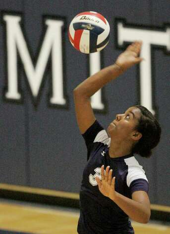 Smithson Valley's Nina Mody-Bailey serves the ball against Poth on Tuesday, Aug. 9, 2011. Poth outlasted Smithson Valley 25-20, 25-22, 20-25, 25-22 in both teams' season opener. Photo: Darren Abate/Special To The Express-News