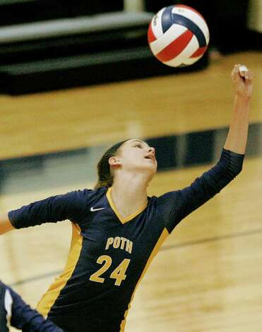 Poth's Micah Weaver reaches for the ball against Smithson Valley on Tuesday, Aug. 9, 2011. Poth outlasted Smithson Valley 25-20, 25-22, 20-25, 25-22 in both teams' season opener. Photo: Darren Abate/Special To The Express-News