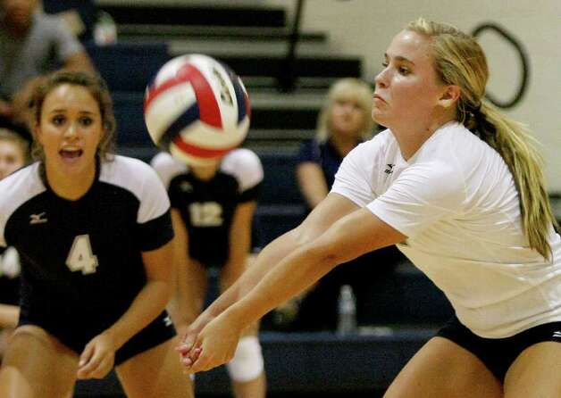 Smithson Valley's Lauren Acuña (left) watches teammate Meghan Uecker dig the ball during an unsuccessful rally against Poth on Tuesday, Aug. 9, 2011. Photo: Darren Abate/Special To The Express-News