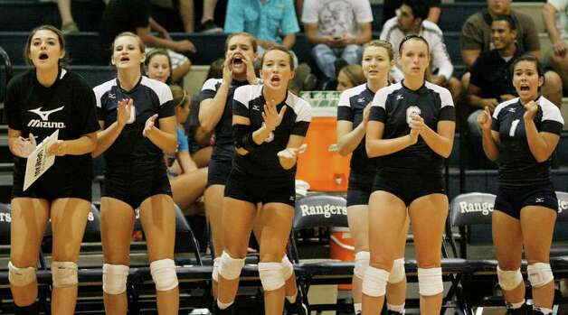 The Smithson Valley bench cheers during a high school volleyball match against Poth on Tuesday, Aug. 9, 2011, at Smithson Valley. Poth outlasted Smithson Valley 25-20, 25-22, 20-25, 25-22 in both teams' season opener. Photo: Darren Abate/Special To The Express-News