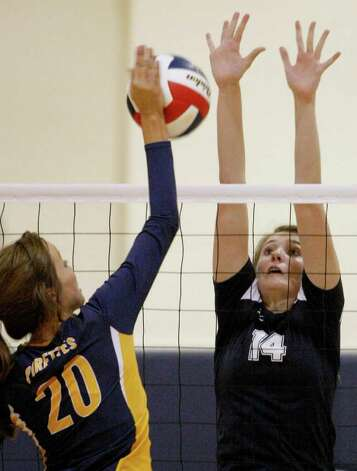 Smithson Valley's Allison Grona (right) defends against Poth's Tara Broyles on Tuesday, Aug. 9, 2011. Poth outlasted Smithson Valley 25-20, 25-22, 20-25, 25-22 in both teams' season opener. Photo: Darren Abate/Special To The Express-News