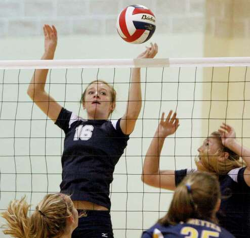 Smithson Valley's Allison Meckel (left) spikes the ball against Poth on Tuesday, Aug. 9, 2011. Photo: Darren Abate/Special To The Express-News