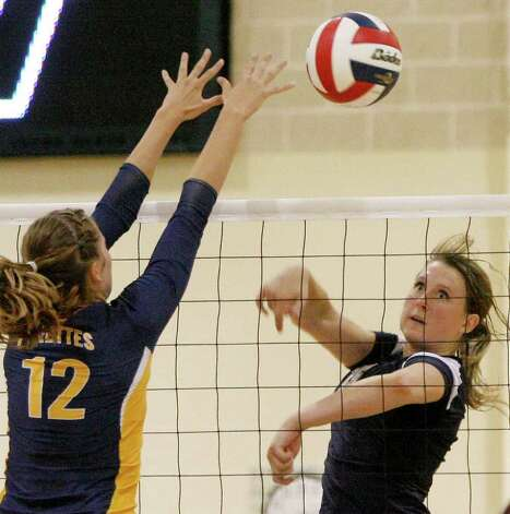 Smithson Valley's Macie McKay defends against Poth's Jordan Kotara on Tuesday, Aug. 9, 2011. Poth outlasted Smithson Valley 25-20, 25-22, 20-25, 25-22 in both teams' season opener. Photo: Darren Abate/Special To The Express-News