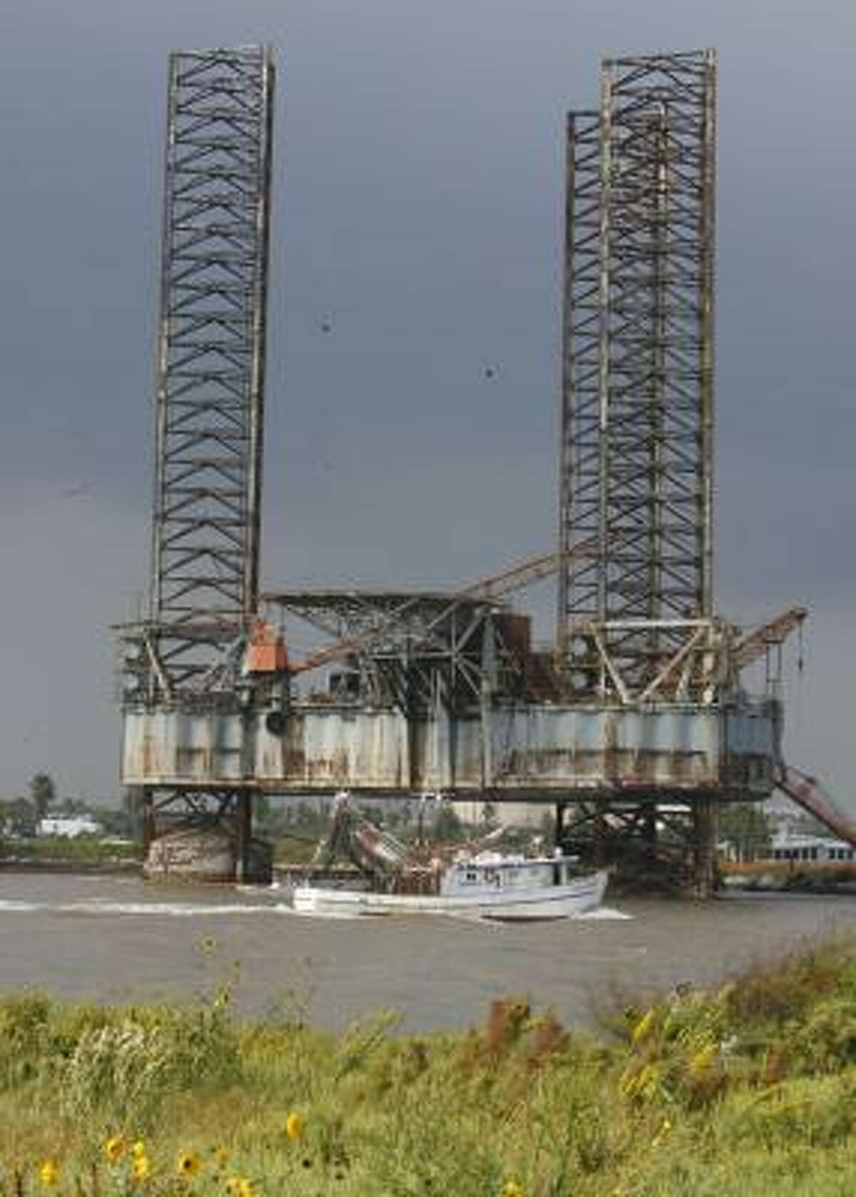 The offshore oil rig Zeus, seen in this October 2006 file photo, has been parked in the Freeport channel for 14 years.