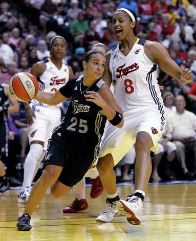 Silver Stars' Becky Hammon (25) gets past Indiana Fever center Tammy Sutton-Brown as she drives during the first half of a WNBA basketball game in Indianapolis, Tuesday, Aug. 9, 2011. Photo: Michael Conroy/Associated Press
