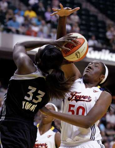 Silver Stars' Sophia Young, left, is fouled as she shoots by Indiana Fever center Jessica Davenport in the first half of a WNBA basketball game in Indianapolis, Tuesday, Aug. 9, 2011. Photo: Michael Conroy/Associated Press