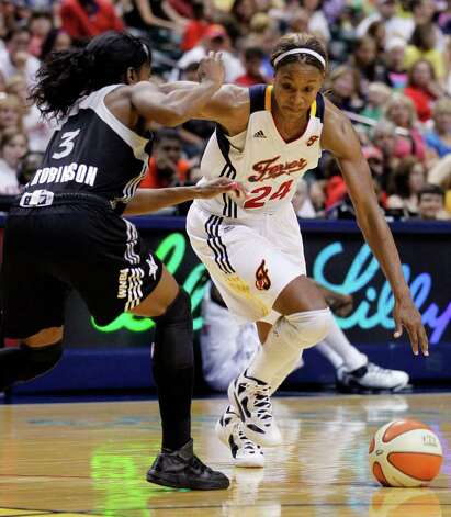 Indiana Fever forward Tamika Catchings, right, drives on Silver Stars' Scholanda Robinson in the second half of a WNBA basketball game in Indianapolis, Tuesday, Aug. 9, 2011. The Fever defeated the Silver Stars 81-68. Photo: Michael Conroy/Associated Press