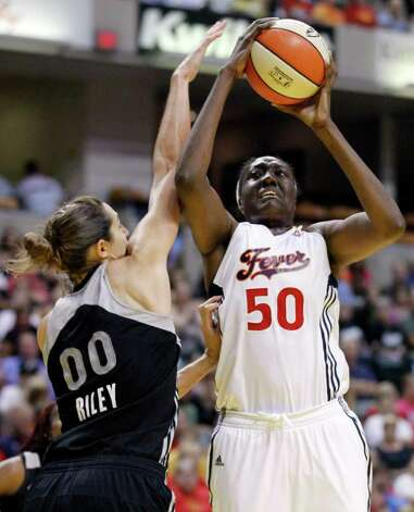 Silver Stars' Ruth Riley, left, fouls Indiana Fever center Jessica Davenport as she shoots in the second half of a WNBA basketball game in Indianapolis, Tuesday, Aug. 9, 2011. The Fever defeated the Silver Stars 81-68. Photo: Michael Conroy/Associated Press