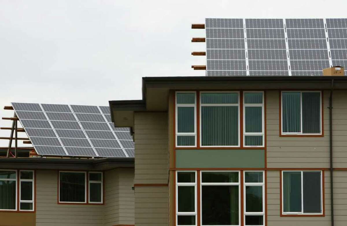 Solar panels sit on the roof of Lake City Village affordable housing in Seattle's Lake City neighborhood. Photographed on Tuesday, August 9, 2011.